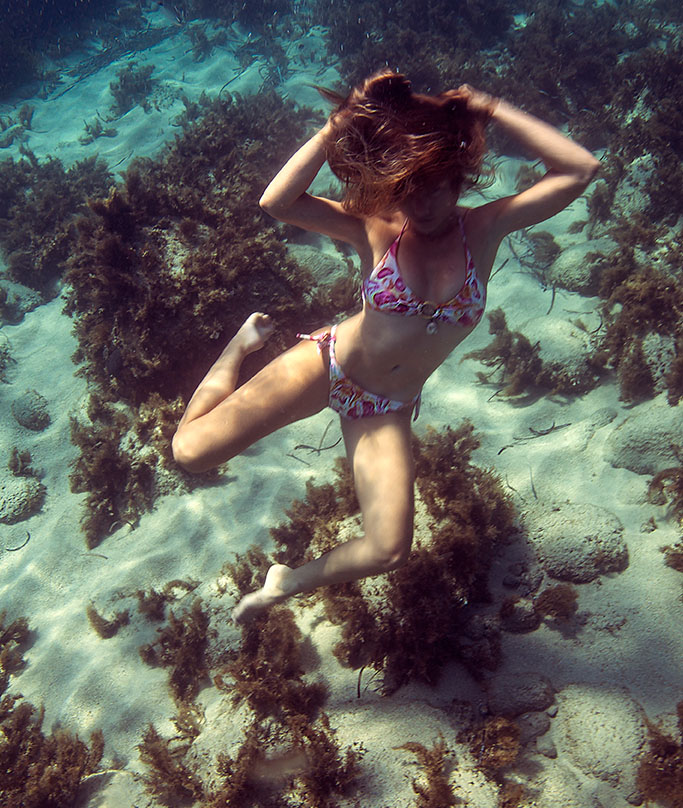 About us page photo of a girl underwater